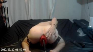 Fuck machine with red veined dildo