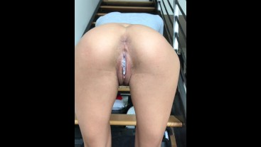 Teen bent over on stairs in front of class