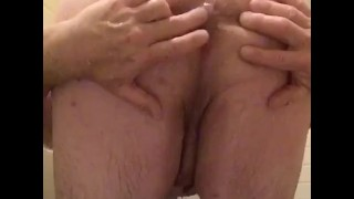 Trying to get my cock hard in the shower while playing w/ myself & fingering my ass while bent over
