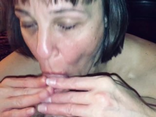 Granny love's sucking our friends cock while I watch and film her.