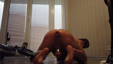Hairy bear puts balls in his wrecked hairy ass hole . Ass stretching big dildo + balls stretching.