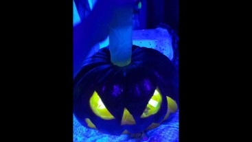 Sexy horny witch conjures up a big pumpkin cock and fucks it like crazy