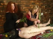 Femdom duo ritualistically flogs cheating slave with flowers