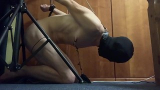 Kneeling predicament self bondage torture; plugged, vibed, cuffed and hooded