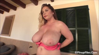 Holly Garner uncovers her big melons with her peach bra