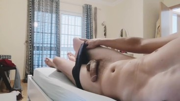 Lying on my bed and stroking my dick until I cum