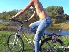 Milf Topless bike ride along river bank (music)