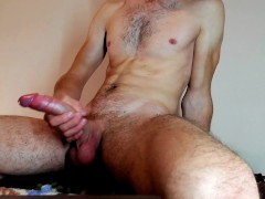 Athletic young student jerks off his big cock and moans
