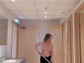 Topless girl mopping public washroom floor