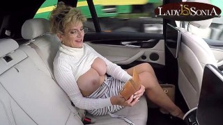 Big boob mature Lady Sonia lets her tits loose in the car