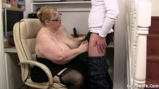 Huge boobs lady boss with glasses rides his cock
