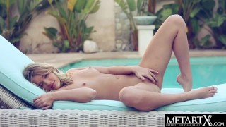 Stunning blonde model with perfect body masturbates by the pool