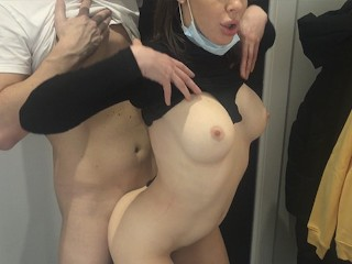 Risky sex in the fitting room with a sales assistant.