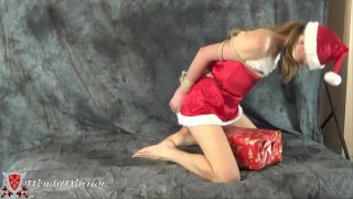 Santa's wife tries to deliver a Christmas tree, but her arms are tied up (video during a photoshoot)