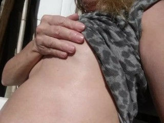 Outdoors playing secretly with my XXL pierced nipples and getting horny