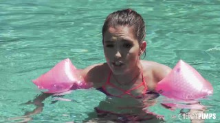 Screen Capture of Video Titled: Beautiful Petite Brunette Proves She Is Big Enough To Swim And Big Enough To Fuck A Huge Cock