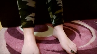Army girl in camo show her boots, socks, sweaty soles and perfect feet with black toenails