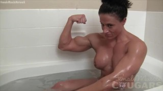 Seyx brunette bodybuilder poses in the bath Big natural muscle