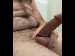 Solo hairy guy masturbating