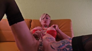 Tanya warms up her pussy with a glass dildo