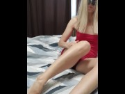Adorable girl in a red sexy dress teases you with her legs
