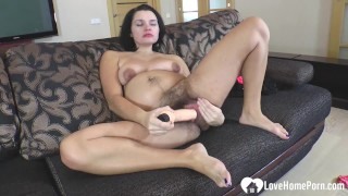 Hot hairy chick uses a big sex toy