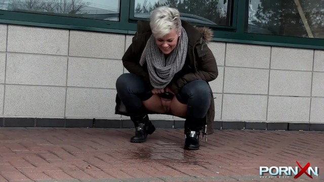 Chesty mature Bree pissing in the public