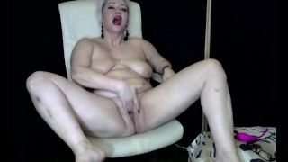 Mature Russian bitch with big tits fucks herself hard with a big dildo