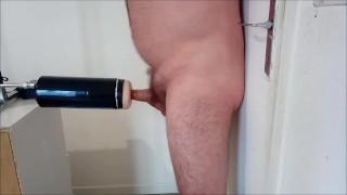 Man tied to a door gets fucked by a masturbator