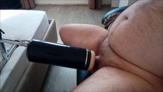 Fuck machine fucks a man tied on a chair