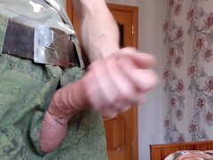 Russian soldier took out his big cock from his pants and fucks an artificial vagina