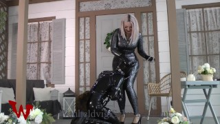 LATEX DOMINATRIX PLAY WITH PUPPY