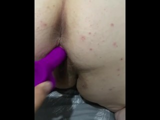 Husband fucks wife's pussy with toy doggy style