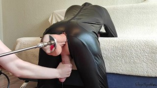 Femboy orgasms by the hand of a kind mistress and a fuck machine