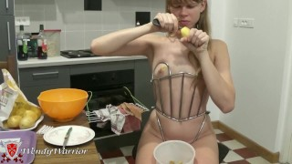 Kitchen tasks: cooking while locked in my Iron Maiden Corset