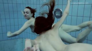Two dressed beauties underwater Anna Netrebko and Lada Poleshuk