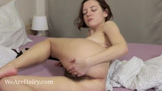 Calina awakens in bed to masturbate